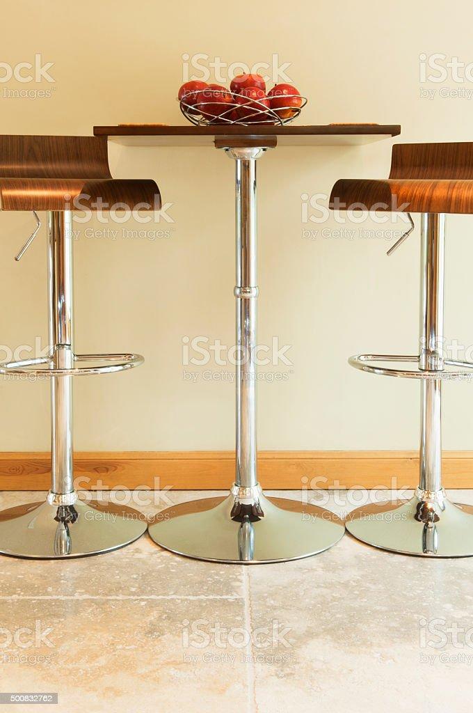 Small kitchen table & stools stock photo