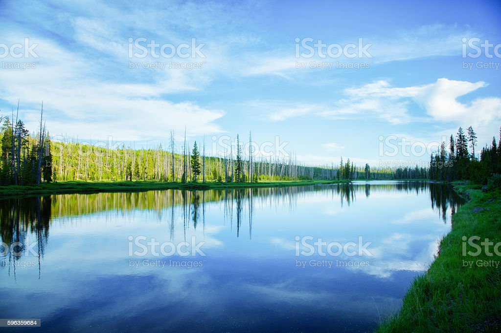 Small lake in Yellowstone park at sunset stock photo