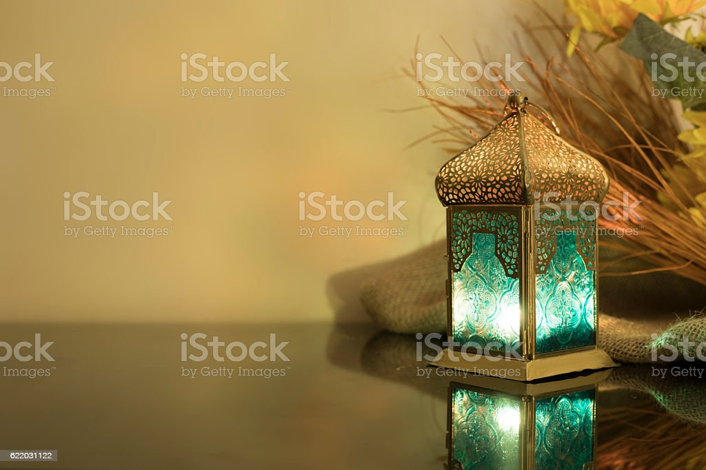 Small Lantern with straw in background stock photo
