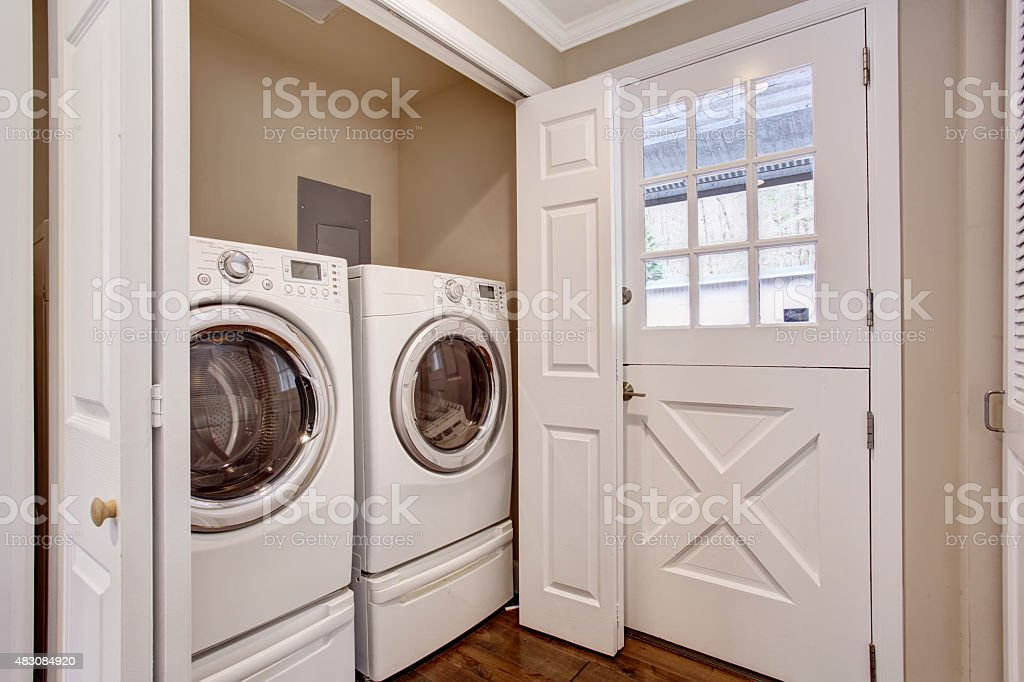 Small laundry area with washer and dryer. stock photo