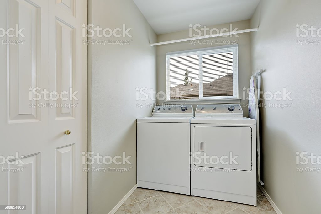 Small laundry room with old fashioned appliances. stock photo