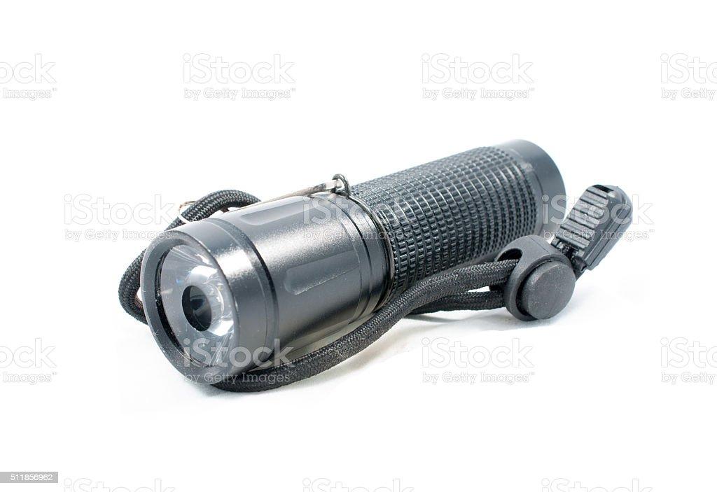 Small LED flashlight isolated on white background stock photo