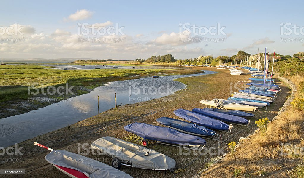 Small leisure boats moored at low tide in marina royalty-free stock photo