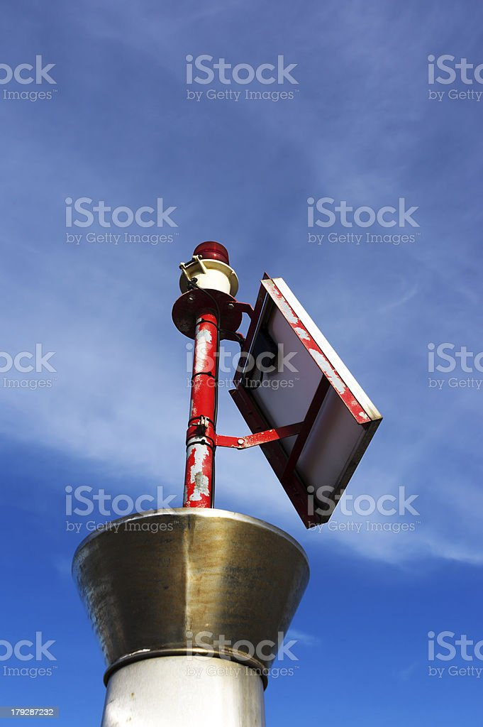 small lighthouse with red bulb royalty-free stock photo