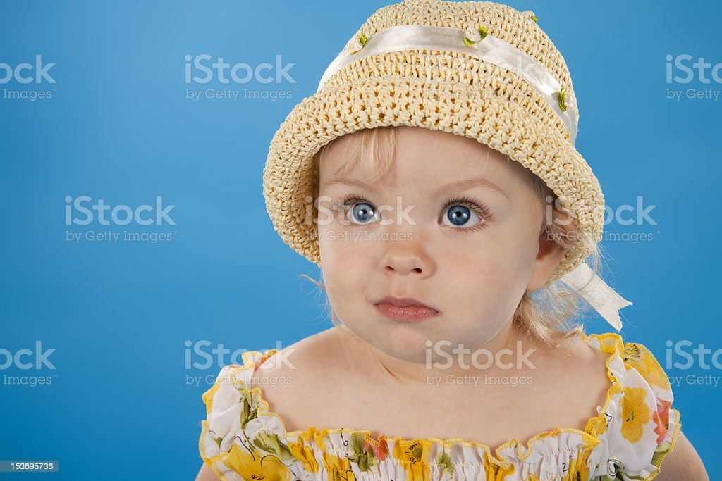 Small lovely girl on a blue background. stock photo