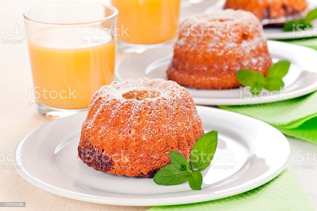 Small marble cakes with juice royalty-free stock photo