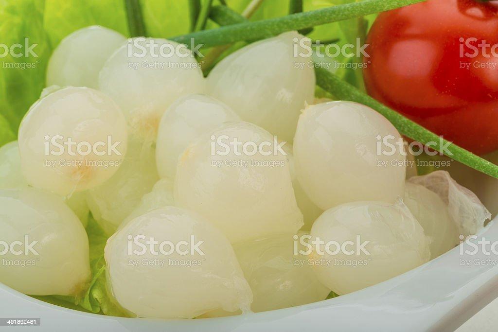 Small marinated onion stock photo