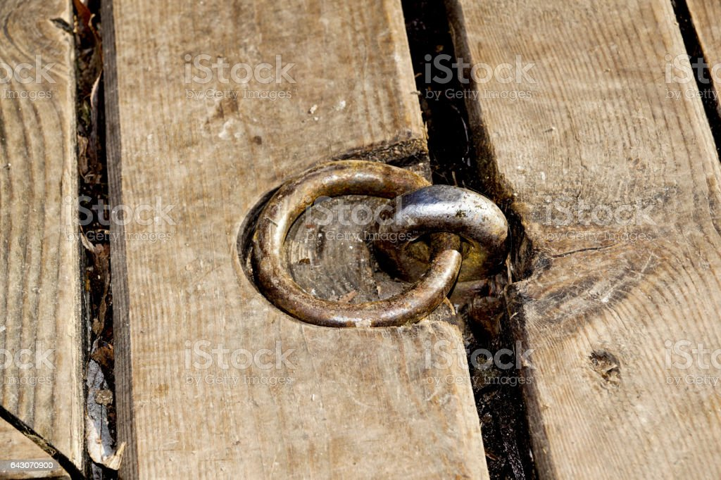 small metal hooks detail on quay for mooring boats, on the wood pier stock photo