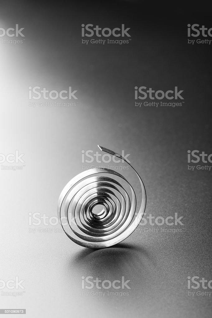 Small metallic spring stock photo