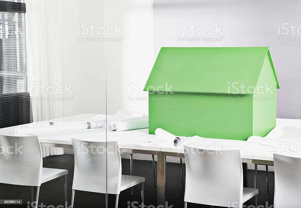 Small model house on conference table royalty-free stock photo