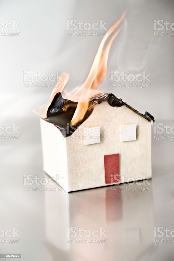 Small Model House on Fire, Studio Shot royalty-free stock photo