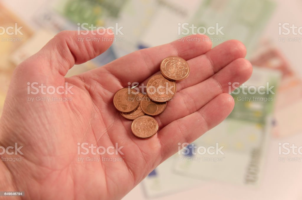 Small money on the palm stock photo