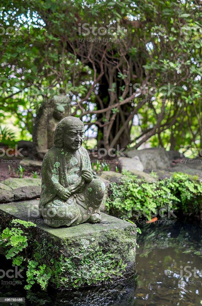 small monk statue stock photo
