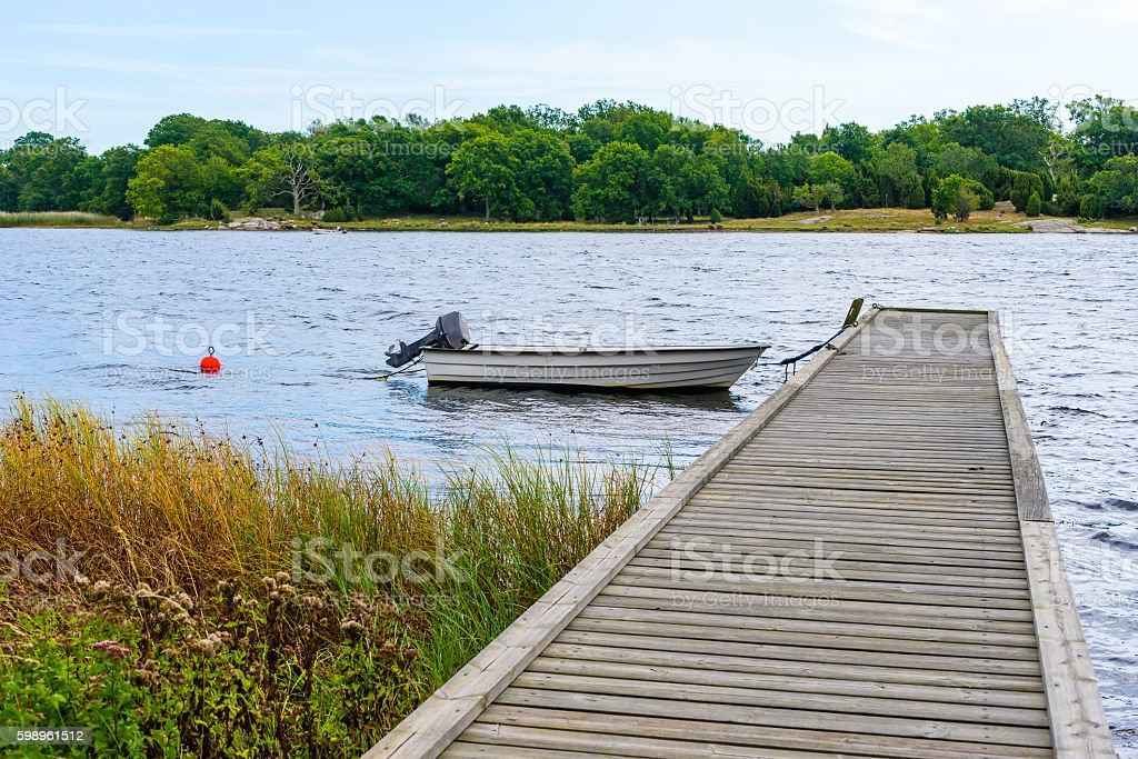 Small moored motorboat stock photo