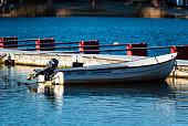 Small motorboat alone in marina