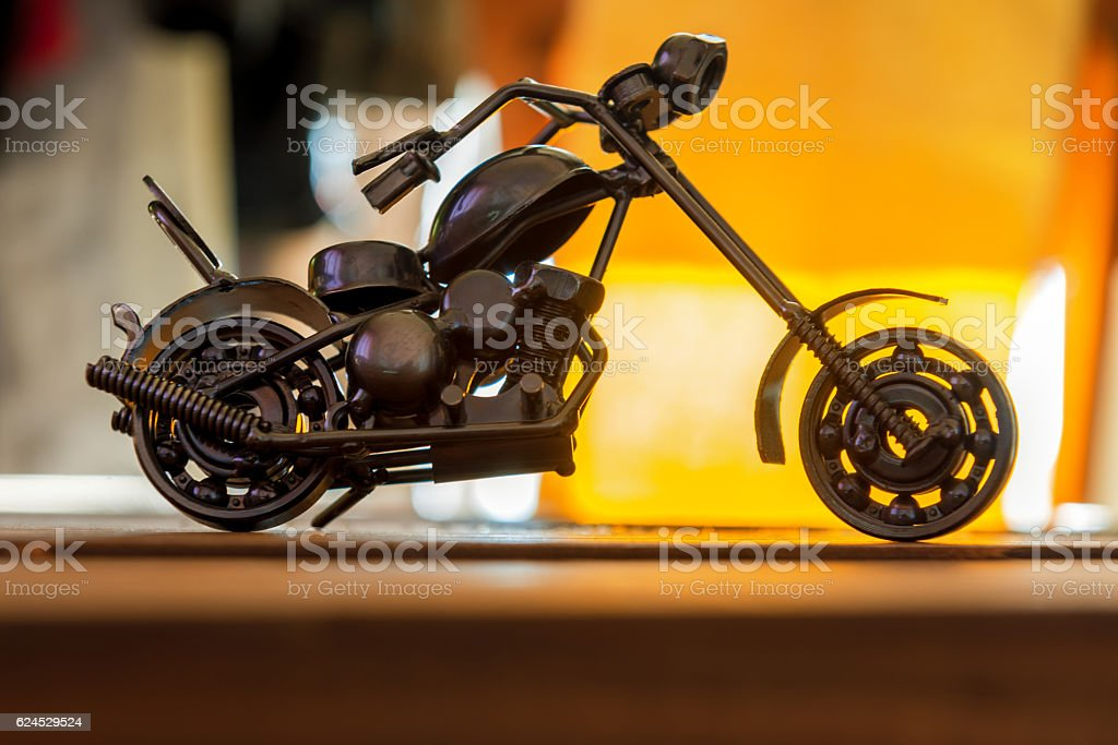 small motorcycle made from nuts and bolts stock photo