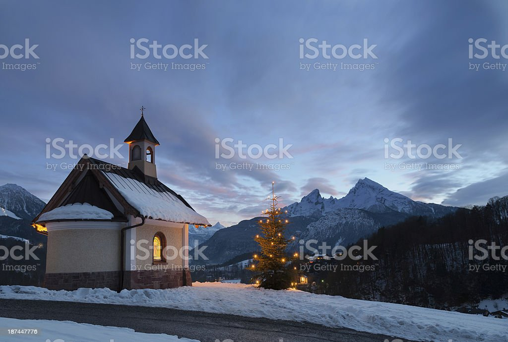 Small mountain chapel with a Christmas tree on the outside stock photo