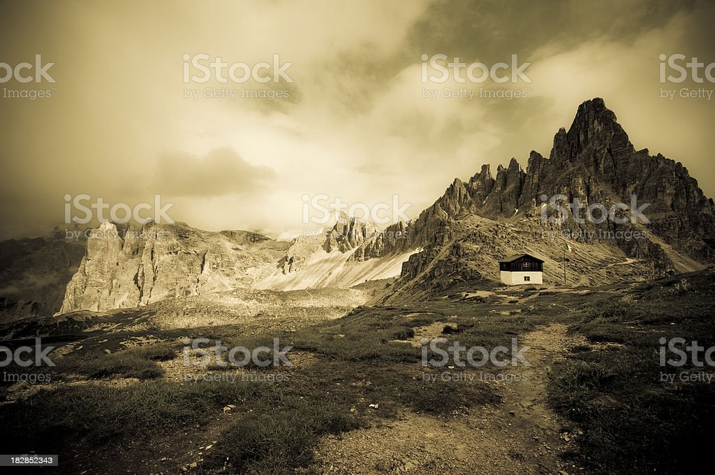 Small mountain hut in the Dolomites stock photo