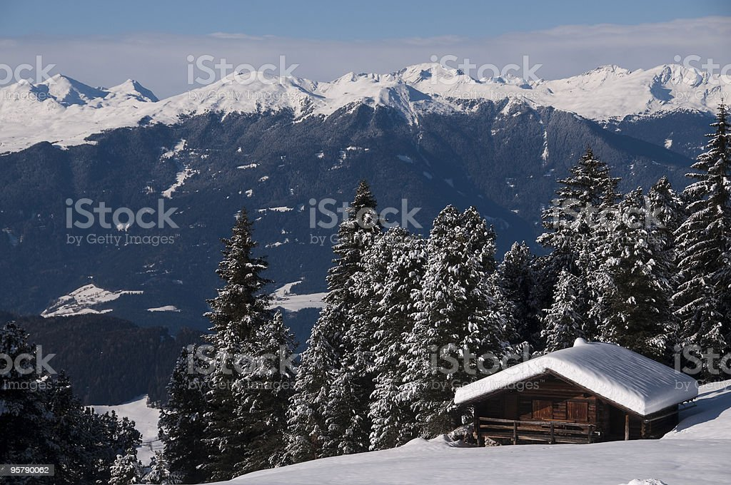 Small mountain hut with panoramic views of the snowy mountains royalty-free stock photo