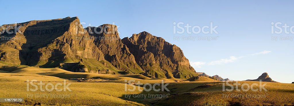 Small mountain range with plains in front stock photo