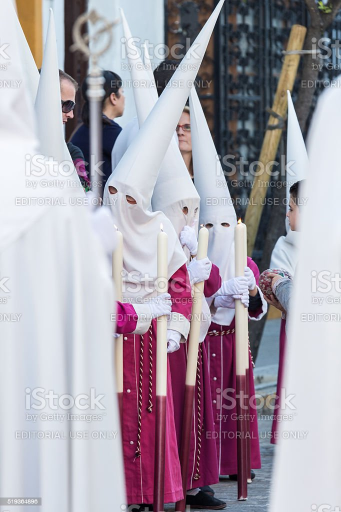 Small Nazarenes during the celebration of Holy Week processions stock photo