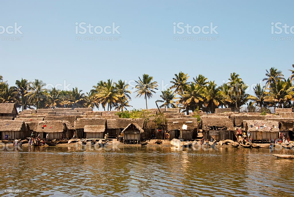 Small nice fisherman village at sunset on the canal stock photo