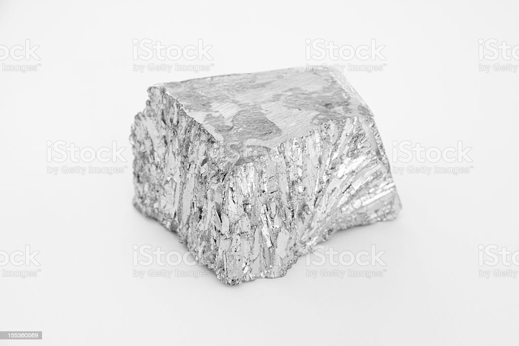 Small nugget of Zinc on a white background stock photo