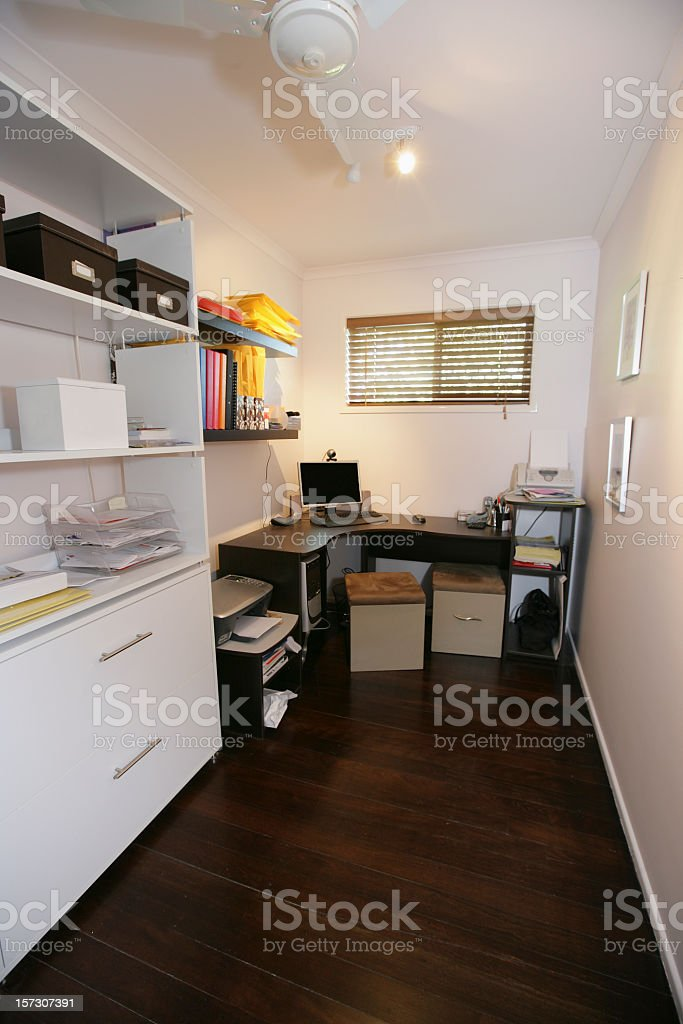 Small office with corner desk and white decor stock photo