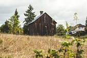 Small, old, brown barn in the countryside