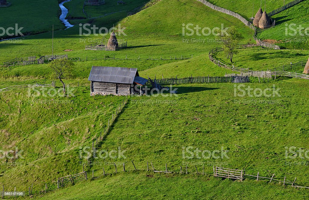 Small old cottage in the meadow stock photo