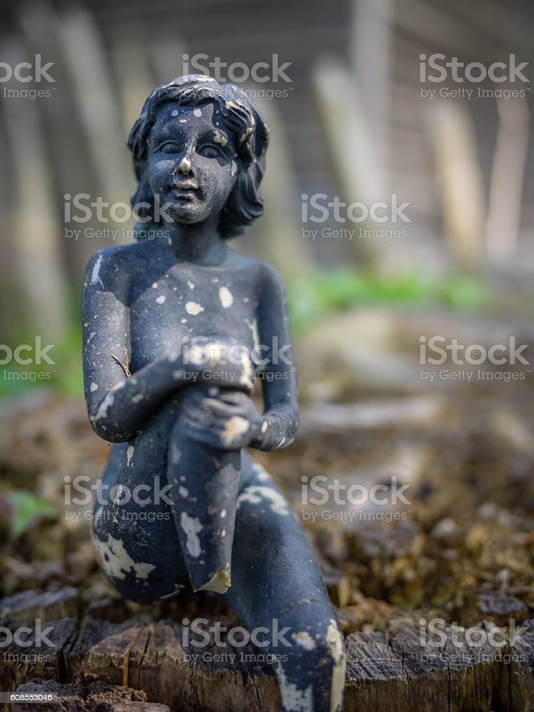 Small old damaged figurine stock photo