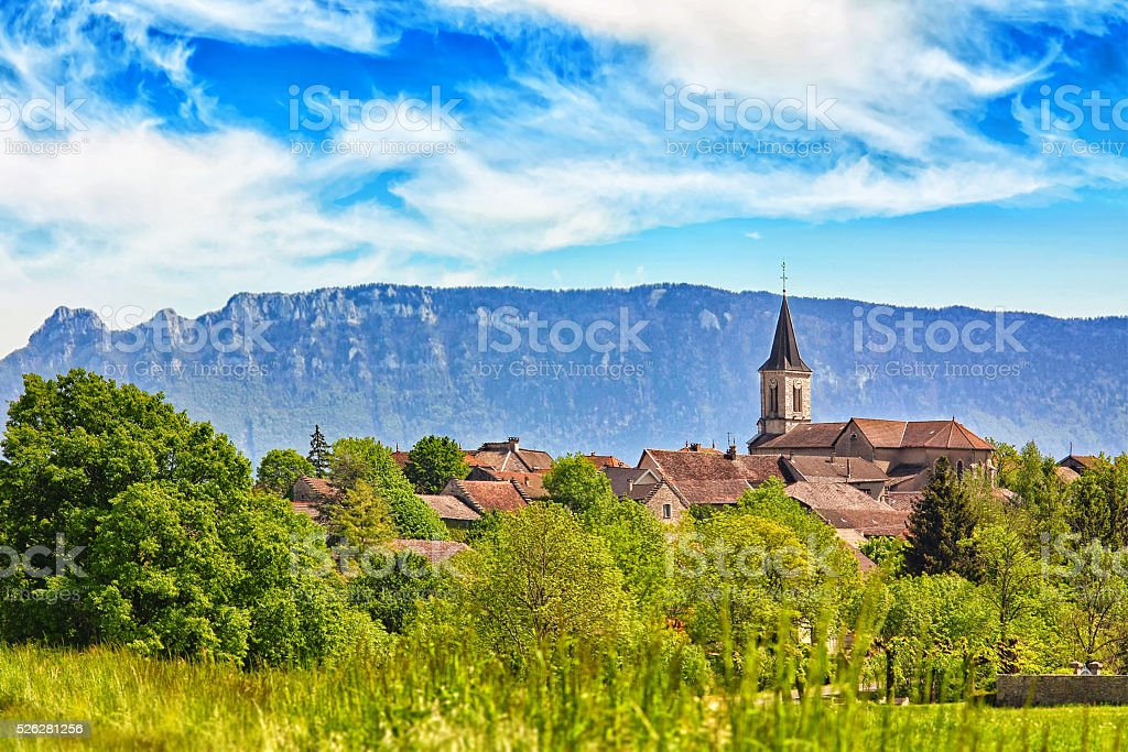 Small old French village in countryside with mountains in background stock photo
