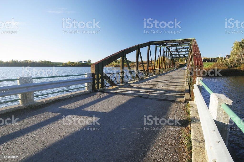 Small one way steel bridge near Hebertville village royalty-free stock photo