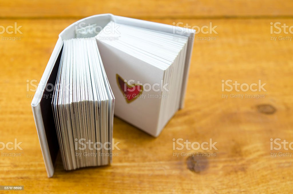 Small open book with a heart shape royalty-free stock photo