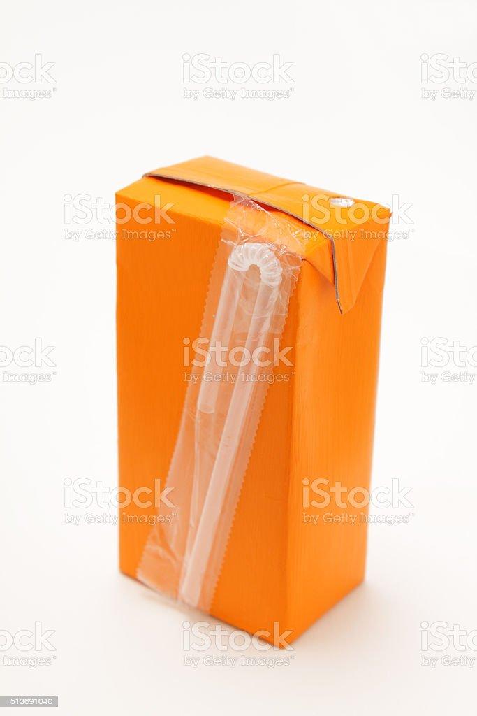 small orange drinks carton with straw stock photo