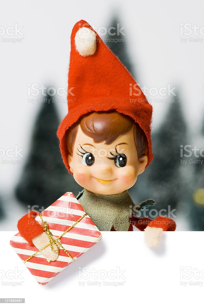 Small ornamental Christmas elf wearing red hat stock photo