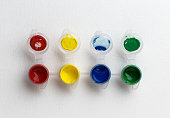 small paint pots on white background