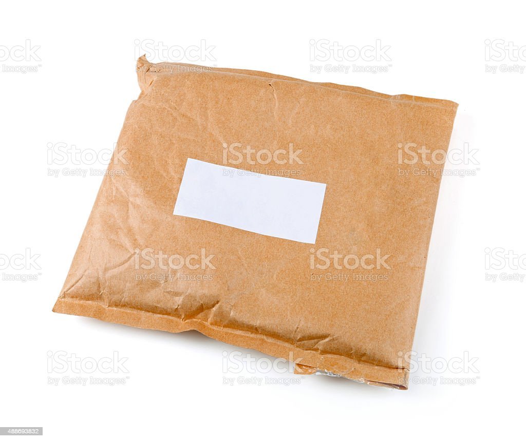 small paper post parcel with blank label stock photo