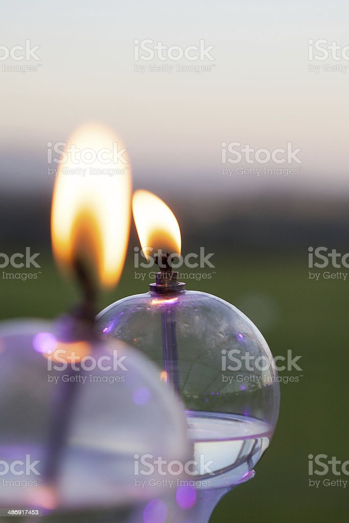 Small parrafin lights burn at night stock photo