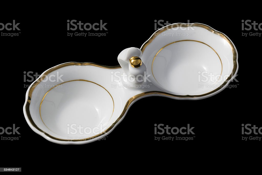 Small partitioned dish with a gold border stock photo