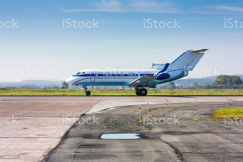 Small passenger airjet heading on the runway royalty-free stock photo