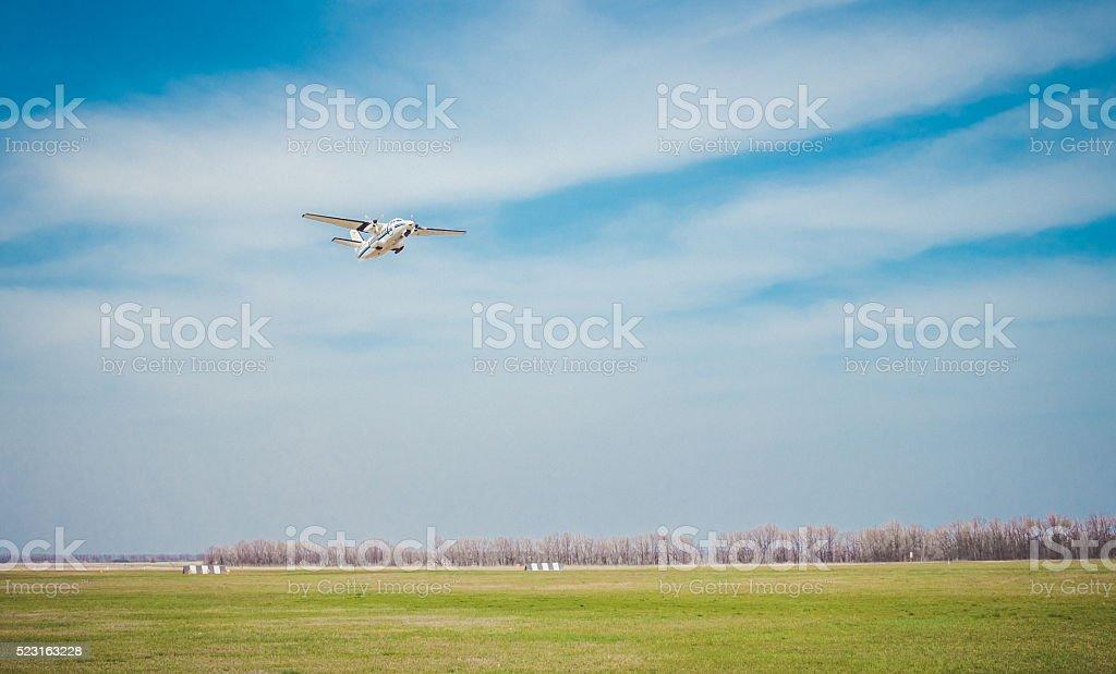 Small passenger plane on takeoff stock photo