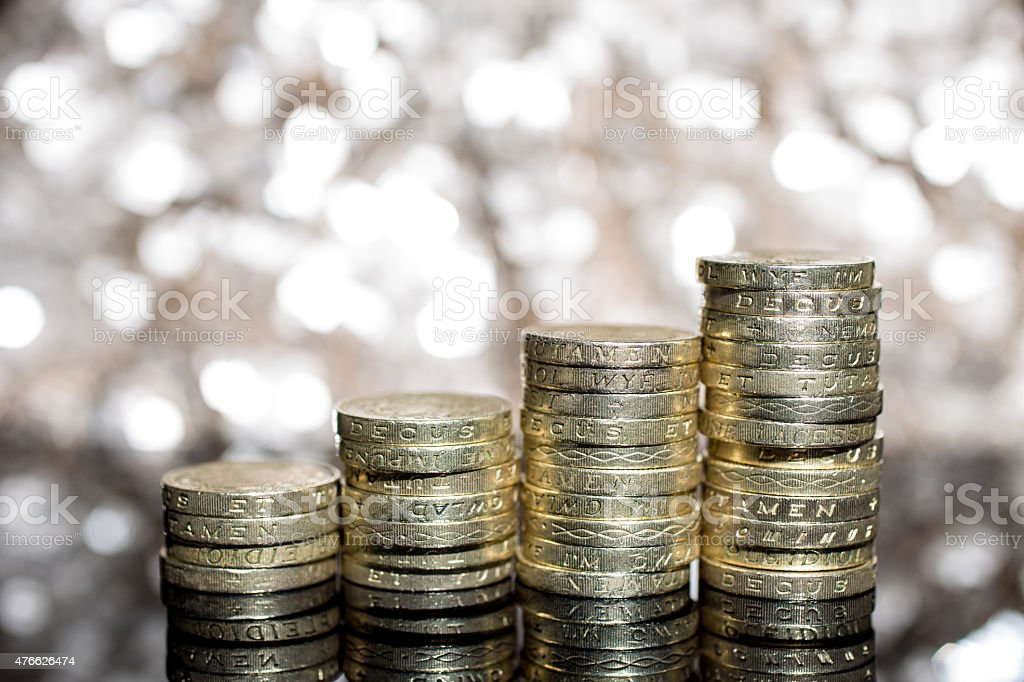 small pile of £1 coins Pound sterling stock photo