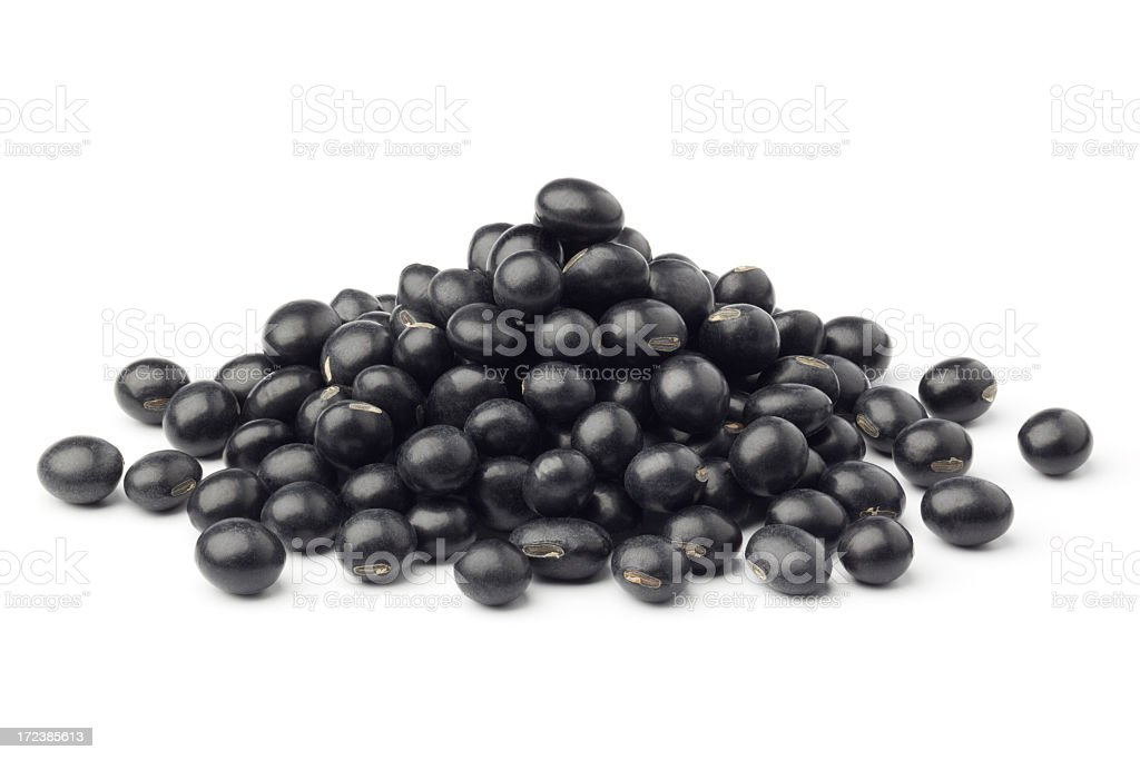 A small pile of black beans on a white background  stock photo