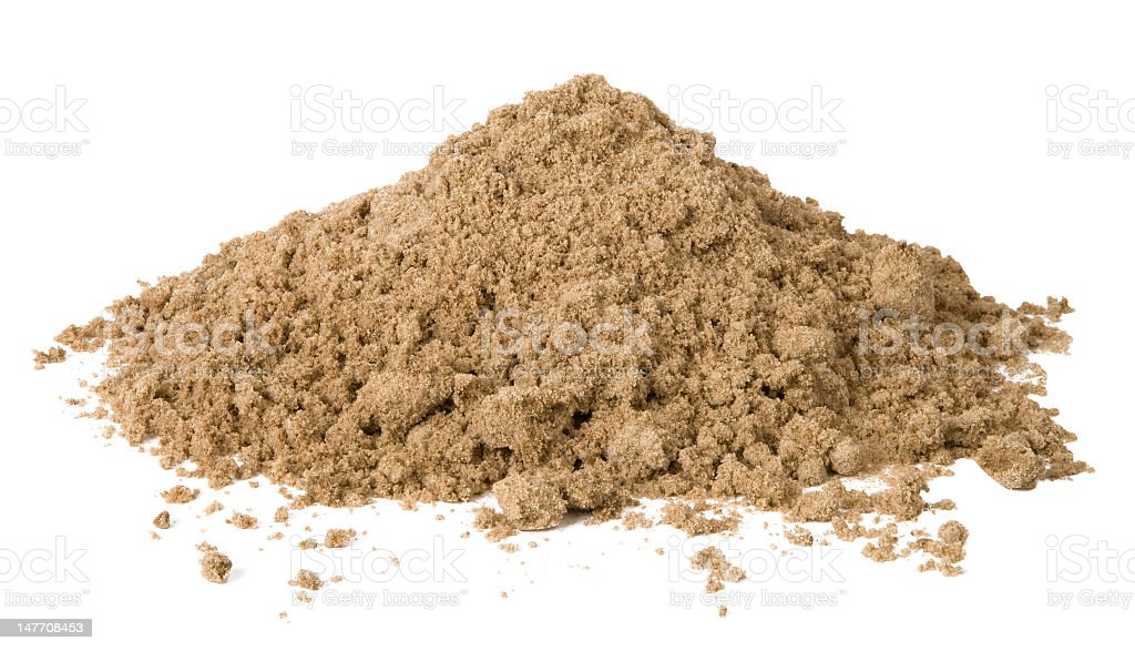 Small pile of loose sand against white background stock photo