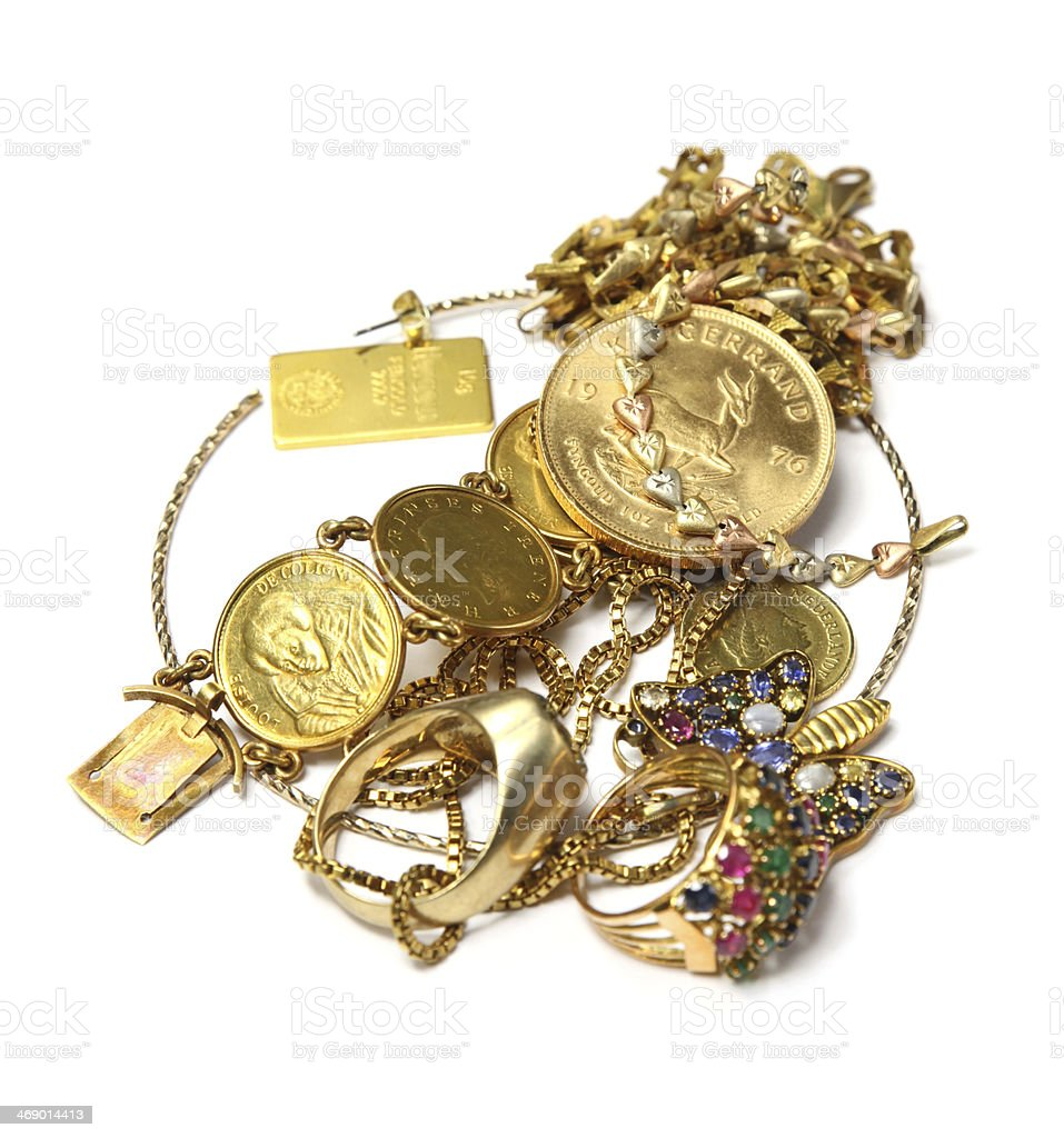 Small pile of random gold pieces, jewelry, and coins stock photo