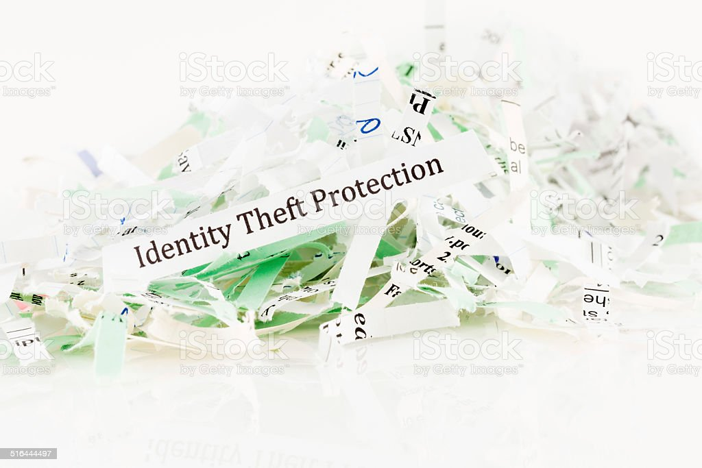 Small pile of shredded paper with Identity theft protection message stock photo