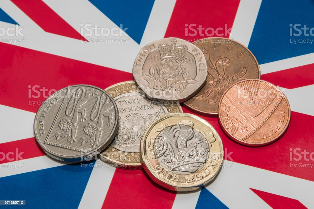 Small pile of UK currency with new 1 pound coin stock photo