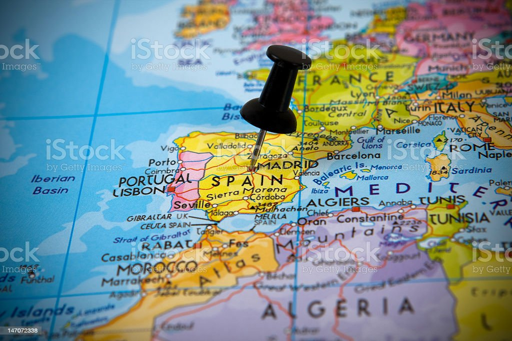 Small pin pointing on Madrid stock photo