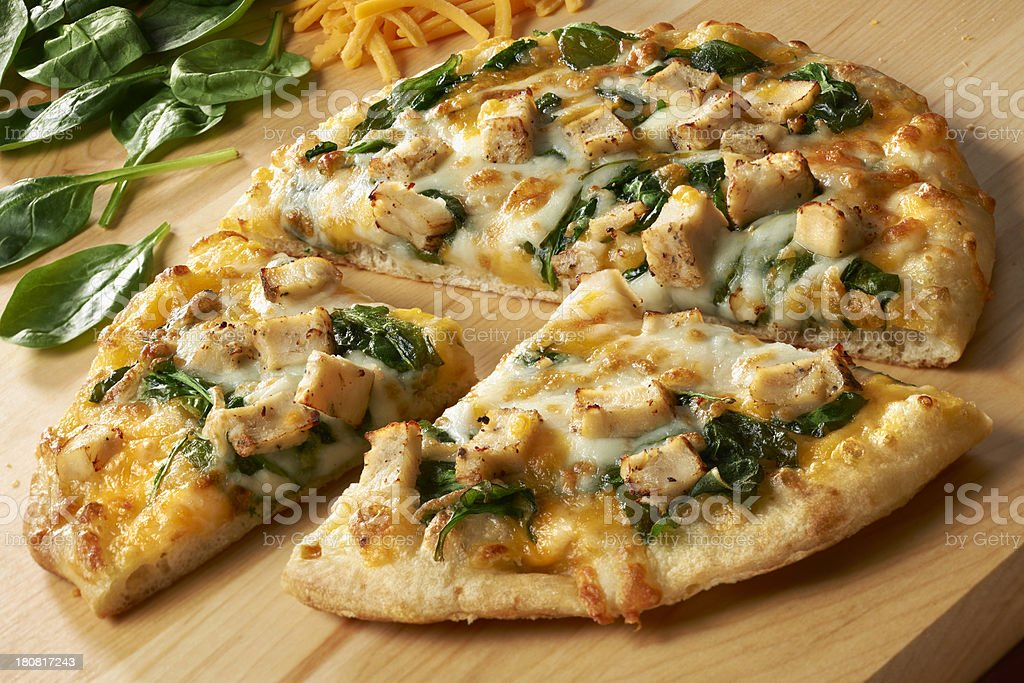 Small Pizza with Chicken, Spinach and double cheese stock photo